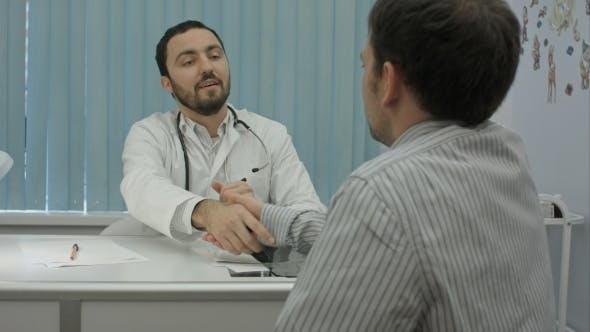 Thumbnail for Male Bearded Doctor In Clinic With Male Patient Shake Hands