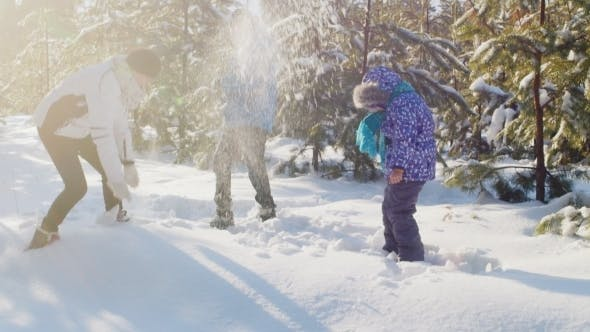 Thumbnail for Mom With Two Kids Playing In The Snow