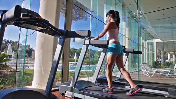 Thumbnail for Woman Running On Treadmill In Gym