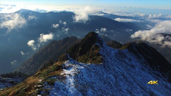 Thumbnail for Aerial First Snow on Mountain Ridge