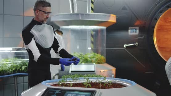 Scientist Planting Seedlings on Martian Base