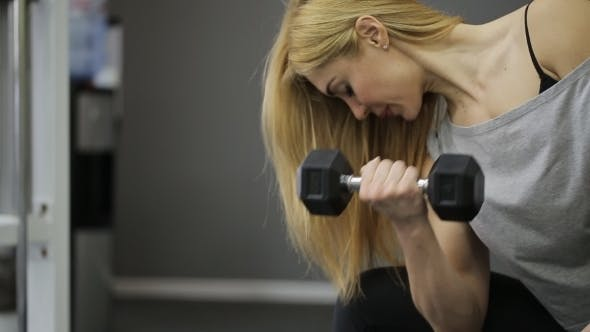 Thumbnail for A Woman Athlete Lifting Dumbbell in the Gym, Training Biceps Muscles