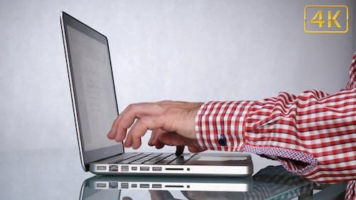 Middle-Aged Man Browsing Internet 4K