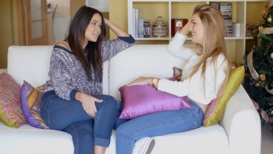 Thumbnail for Two Adorable Girls Sitting On Couch And Talking