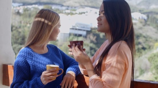 Thumbnail for Young Women Chatting On An Open-air Patio