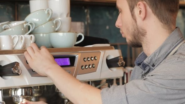 Thumbnail for Barista Makes Coffee With a Coffe Machine