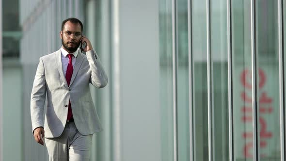 Thumbnail for Front View of African American Businessman Talking on Smartphone