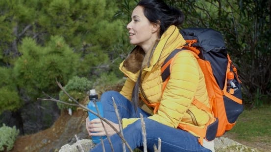 Thumbnail for Young Backpacker Pausing For Water