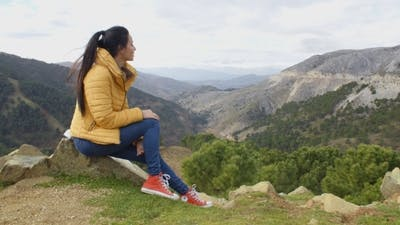Calm Woman Looking Into Valley
