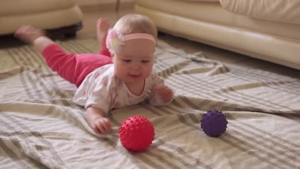 Thumbnail for Toddler Funny Playing with Toy Ball on Floor
