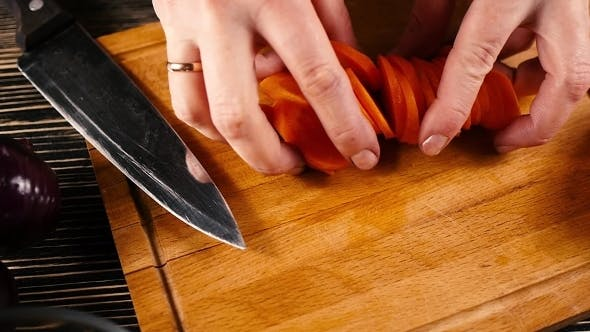 Of a Chef Carefully Cutting Some Carrots
