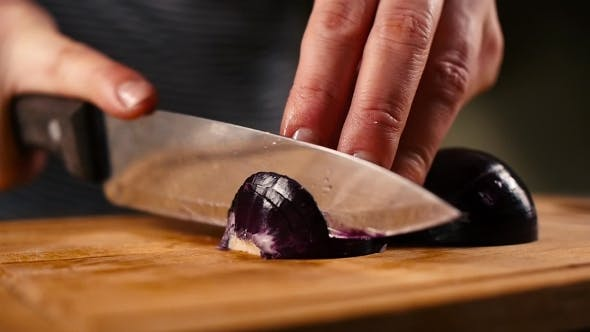 Thumbnail for Woman Hands Slicing Onions On a Wooden Cutting Board