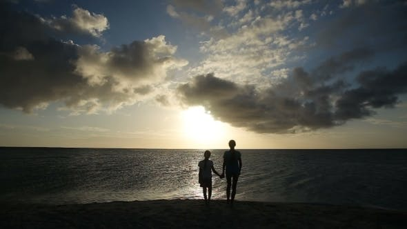 Thumbnail for Silhouette Of Girls On The Beach At Sunset