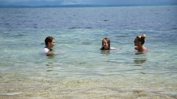Thumbnail for Mother And Daughters Playing In The Tropical Sea