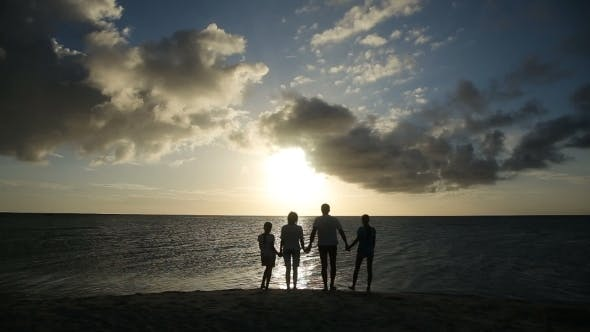 Thumbnail for Silhouette Of Family On The Beach At Sunset