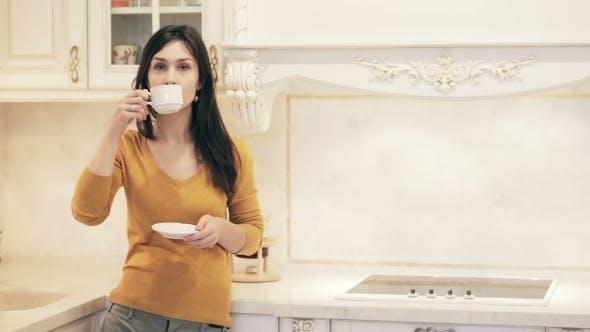 Thumbnail for Young Beautiful Girl Enjoying Coffee In Kitchen