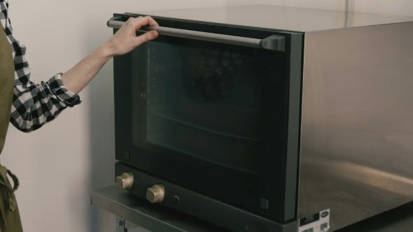 Thumbnail for Woman Cooks Food In An Oven