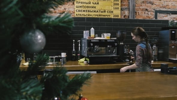 Thumbnail for Woman Makes Coffee At The Bar Counter