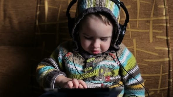 Thumbnail for Little Boy With Headphones Browse Tablet Pc