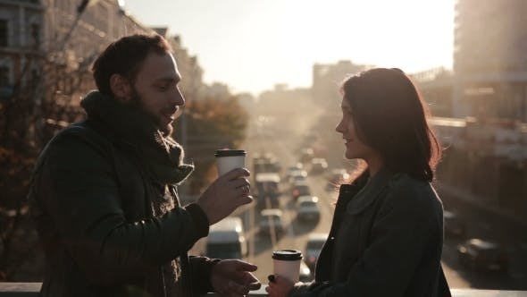 Thumbnail for Couple Talking and Drinking Coffee on a  Bridge