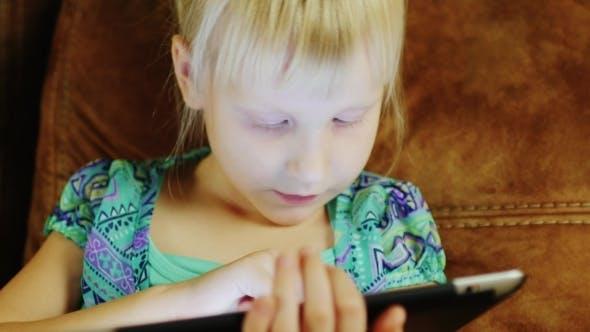 Thumbnail for Girl Playing Game On Tablet