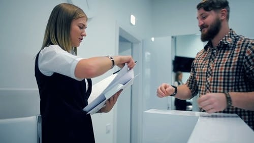 Administrator Conveys Questionnaire To Client