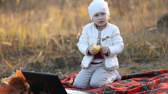 Thumbnail for Child Eating An Apple