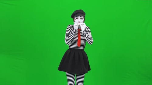 Mime Girl Is Inflating a Balloon