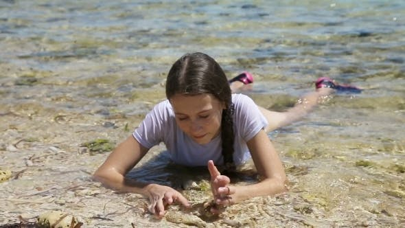 Thumbnail for Happy Child Playing With Sand On Beach In Summer