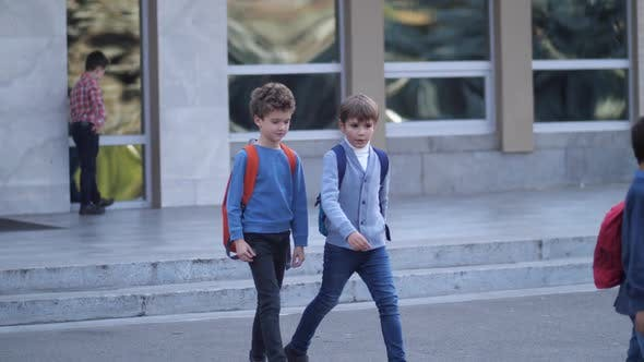 Thumbnail for Preteen Schoolboys Talking While Leaving School