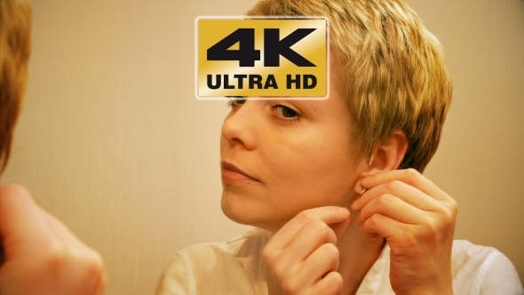 Thumbnail for Pretty Blond Woman Wears Earrings And Smartens Up