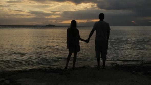 Thumbnail for Sunset Silhouette Of Couple On The Beach