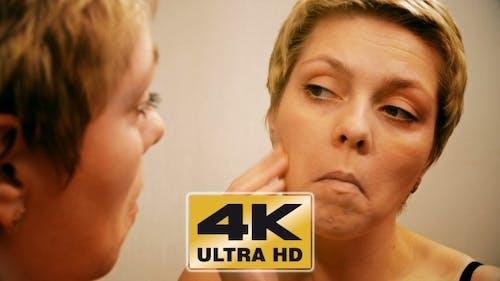 Woman Applies Make-up Concealer Foundation Cream