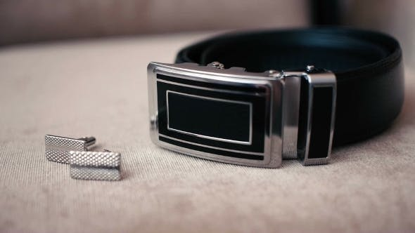 Accessories Groom Lying On a Chair, Cuff Links And Belt