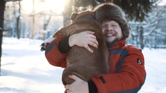 Thumbnail for Man Hugs His Dog