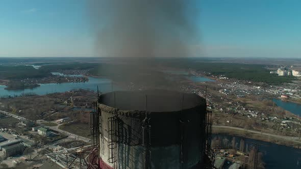 Thumbnail for Aerial View Around Smoking Chimneys of CHP Plant, Extreme Close-up