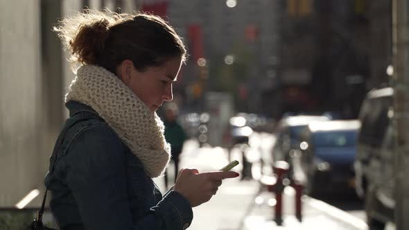 Thumbnail for A Beautiful Woman Looks At Phone 1