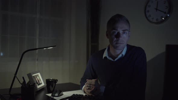 Thumbnail for Serious Man At His Office Desk