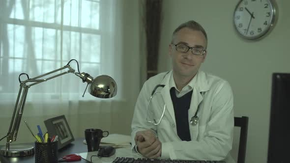 Cover Image for Doctor At His Office Desk