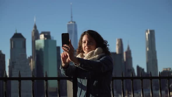 Thumbnail for A Beautiful Woman Taking Selfies, Nyc Skyline In Background 1