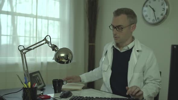 Thumbnail for Doctor Working At His Office Desk 13