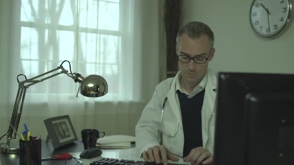 Thumbnail for Doctor Working At His Office Desk 14