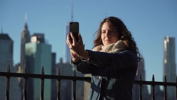 Thumbnail for A Beautiful Woman Taking Selfies, Nyc Skyline In Background 2