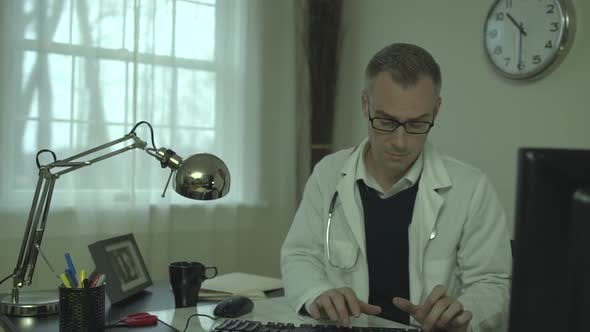 Thumbnail for Doctor Working At His Office Desk 15