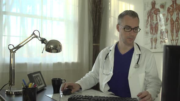 Thumbnail for Doctor Working At His Office Desk 17
