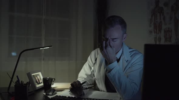 Thumbnail for Stressed Doctor Working At His Office Desk 3