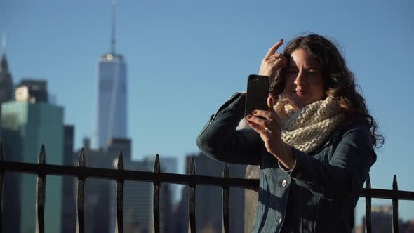 Thumbnail for A Beautiful Woman Taking Selfies, Nyc Skyline In Background 4