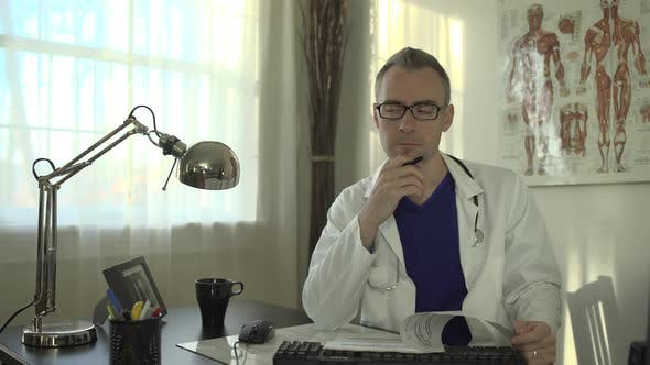 Thumbnail for Doctor Working At His Office Desk 19
