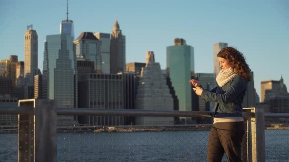 Thumbnail for A Beautiful Woman Taking Selfies, Nyc Skyline In Background 5