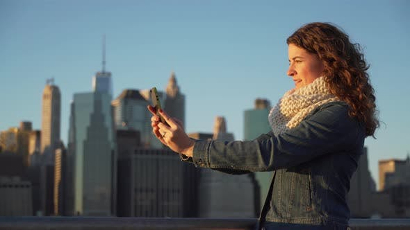 Thumbnail for A Beautiful Woman Taking Selfies, Nyc Skyline In Background 7